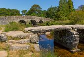 picture of devonshire  - Both bridges at the river crossing in Postbridge Dartmoor National Park Devon England UK - JPG