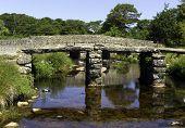 foto of devonshire  - Postbridge ancient clapper bridge in Dartmoor National Park Devon England UK - JPG