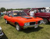 1972 Red With Black Stripes Olds Cutlass Side View