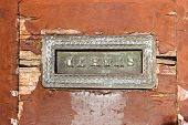 Old Mail Slot In A Wooden Door