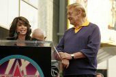 Paula Abdul and Jerry Buss at the Ceremony Honoring Los Angeles Lakers Owner Jerry Buss with the 2,323rd star on the Hollywood Walk of Fame. Hollywood Boulevard, Hollywood, CA. 10-30-06