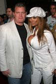John Edward Yarbrough and Traci Bingham at the DVD Release of