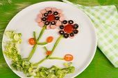 pic of olive shaped  - Salad in an attractive flower shaped serving kid food - JPG