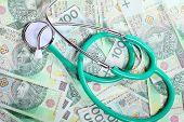 Cost Of Health Care: Stethoscope On Polish Money