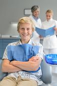 Teenager boy dental checkup dentist assistant standing at stomatology clinic