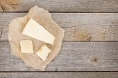 Parmesan cheese on wooden table background with copy space