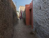 Harar. Ethiopia - December 23, 2013: Young Boy Running As He Is Late For School In Narrow Alleyway O