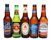 IRVINE, CALIFORNIA - JULY 14, 2014: 5 bottles of assorted cold beers. Domestic and Imported brews in