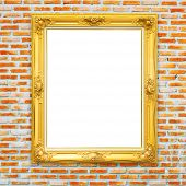 golden classic photo frame on bricked wall background