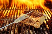 stock photo of brisket  - Grilled pork brisket and flaming grill in background - JPG