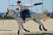 LYTKARINO, MOSCOW REGION, RUSSIA - JULY 12, 2014: Maria Artishcheva performs stunts during Russian championship in trick riding. Lytkarino housed the Russian Federation of trick riding