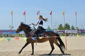 LYTKARINO, MOSCOW REGION, RUSSIA - JULY 12, 2014: Victoria Dubasova performs stunts during Russian championship in trick riding. Lytkarino housed the Russian Federation of trick riding