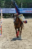 LYTKARINO, MOSCOW REGION, RUSSIA - JULY 12, 2014: Anton Portnov from Moscow performs stunts during Russian championship in trick riding. Lytkarino housed the Russian Federation of trick riding