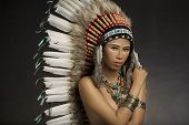 foto of indian chief  - Girl wearing Native American Indian headdress and jewelry and face paint - JPG