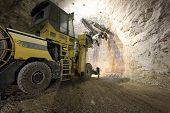 picture of machinery  - Big loader and big machinery in a dark mine - JPG