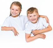 happy boy and girl behind white banner with space for text