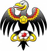 German black eagle celebrating with a soccer ball