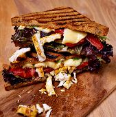 Chicken club sandwich on wooden board