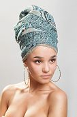 stock photo of turban  - sexy girl with bare shoulders in a turban - JPG