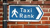 Signpost Points To A Taxi Rank