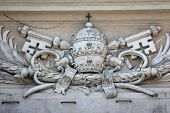 PARMA,ITALY-MAY 01,2014: Papal coat of arms at St Peter's Church.Parma is famous for its ham,cheese