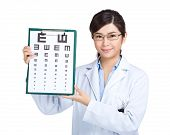 Optician doctor show with eye chart