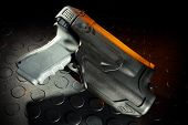 stock photo of handgun  - Polymer handgun holster that is designed for law enforcement - JPG