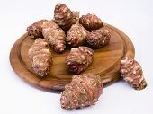 picture of jerusalem artichokes  - Topinambur root on a round board - JPG
