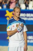 MOSCOW, RUSSIA - JULY 13, 2014: A. Peremitin, Russia sings the national anthem before the match with Spain during Moscow stage of Euro Beach Soccer League. Russia won 4-1 and took the first place