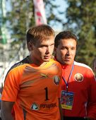 MOSCOW, RUSSIA - JULY 13, 2014: Goalkeeper Valery Makarevich and the coach of Belarus team Siarhei Tresko after the match with Greece during Moscow stage of Euro Beach Soccer League. Belarus won 6:5