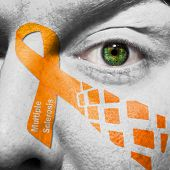 Orange Multiple Sclerosis Ribbon Painted On Face