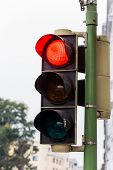 a traffic light with red light. symbolic photo for maintenance, economic, failure