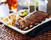 full rack of baby back ribs in barbecue sauce