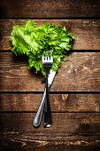 Fresh Salad Over Wooden Table With Knife And Fork.  Diet Food And Healthy Lifestyle Concept Macro.