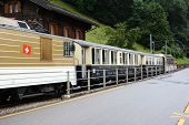 BROC, SWITZERLAND - JULY 8, 2014: The Chocolate Train at station. The vintage luxury tourist train d