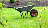 Garden-wheelbarrow On Green Grass