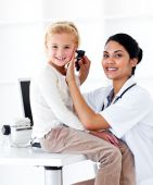 Smiling Female Doctor Checking Her Patient's Ears