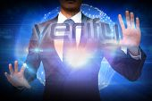 Businessman presenting the word verify against futuristic shiny 3d ball