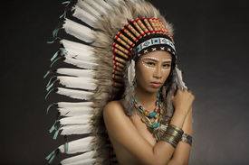 image of indian chief  - Girl wearing Native American Indian headdress and jewelry and face paint - JPG