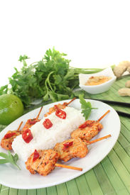 stock photo of sate  - Asian sate skewers with rice and peanut sauce