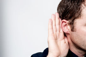 image of middle finger  - Listening male holds his hand near his ear - JPG