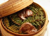 Venison steaks smoked with pine branches, Scandinavian gourmet food