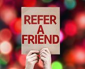 Refer a Friend card with colorful background with defocused lights