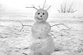 Christmas snowman sitting in a snowy outdoors