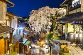 Kyoto, Japan alleyway scene in the Higashiyama district at night during the spring season.
