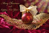 Crimson Christmas Bauble On Openwork Golden Leaf