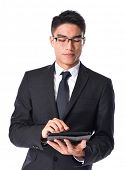 Happy Young businessman Using Digital Tablet Isolated