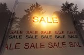 sale poster in the display window of shop
