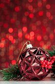 Christmas ball on sparkles background