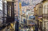 LA PAZ, BOLIVIA, MAY 8, 2014: A tangle of electric cables hangs over the street